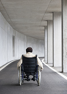 Austria, Senior woman on wheelchair at Subway - WWF002030
