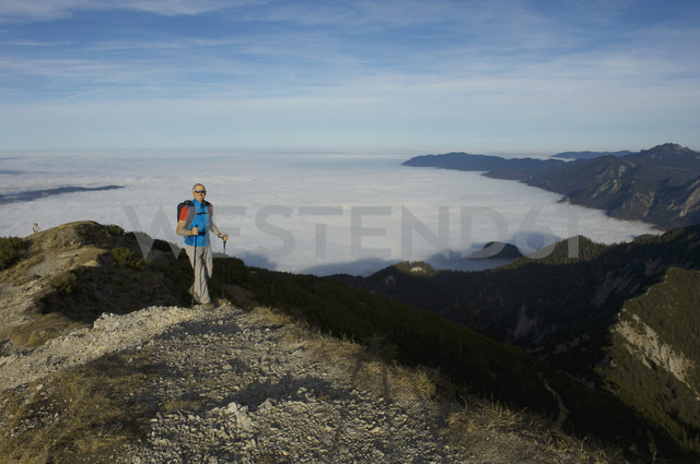 Germany, Bavaria, Walchesee Region, Hiker on mountain - MIRF000359
