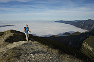 Germany, Bavaria, Walchesee Region, Hiker on mountain - MIRF000359