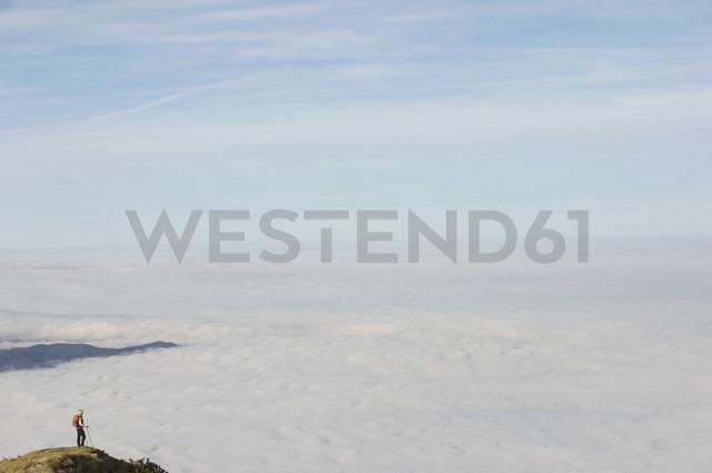 Germany, Bavaria, Walchesee Region, Hiker on mountain - MIRF000362
