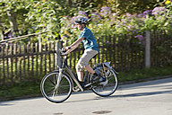 Germany, Bavaria, Mature man riding electric bicycle - DSF000246