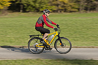 Germany, Bavaria, Mature man riding electric bicycle - DSF000252
