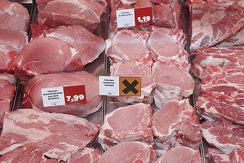 Germany, Fresh meat at counter - THF001175