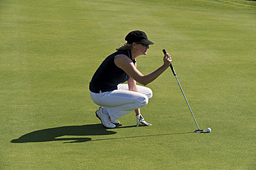 Cyprus, Woman playing golf on golf course - GNF001215