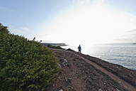 Portugal,Algarve,  Mature man jogging by coast - MIRF000366