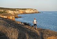 Portugal,Algarve,  Mature man jogging by coast - MIRF000369