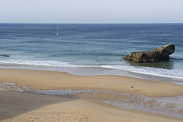 Portugal, Algarve, Senior woman jogging by coast - MIRF000375