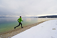 Germany, Mature man jogging by Walchensee Lake - MIRF000378