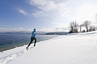 Germany, Mature man jogging by Walchensee Lake - MIRF000381