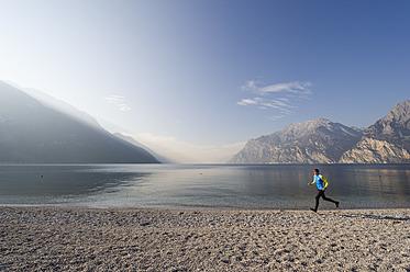 Italy, Mature man jogging by Lake Garda - MIRF000393