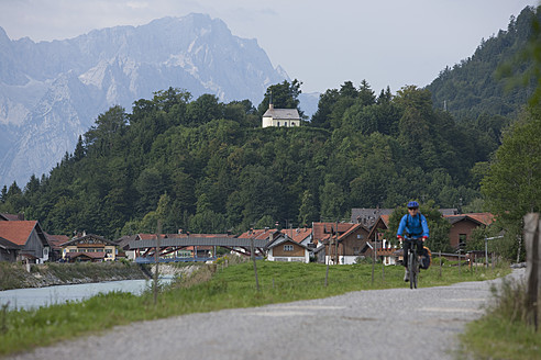 Germany, Bavaria, Eschenlohe, Mature man riding bicycle - DSF000222