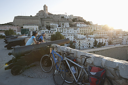 Spain, Ibiza, Eivissa, Mature man and mid adult woman with bicycle - DSF000321