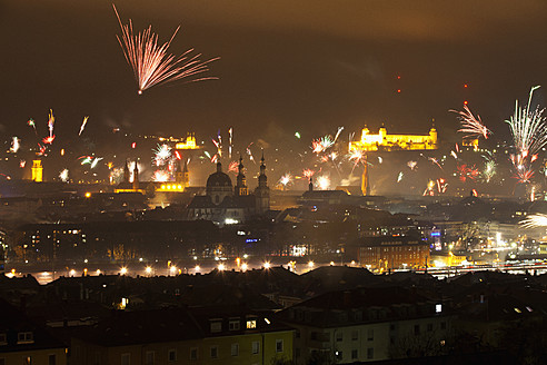 Germany, Bavaria, Wuerzburg, Firework display over cityscape - NDF000255