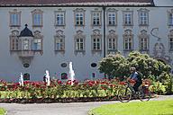Germany, Bavaria, Man cycling by Abbey Scheyern - DSF000327
