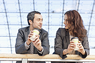 Germany, Leipzig, Business people having coffee, smiling - WESTF018459