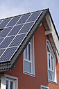 Europe, Germany, Bavaria, Munich, Solar panels on roof - TCF002274