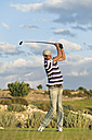 Cyprus, Man playing golf on golf course - GNF001212