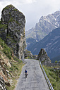 Switzerland, Mature man cycling through mountain road - DSF000402