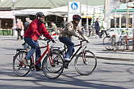 Germany, Bavaria, Munich, Man and woman riding bicycle - DSF000488