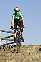 Germany, Bavaria, Munich, Mature man riding bicycle - DSF000524