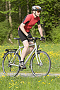 Germany, Bavaria, Mature man riding bicycle - DSF000468