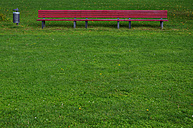 Germany, View of red bench in park - AXF000012