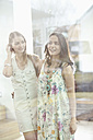 Germany, Bavaria, Young women looking away, smiling - MAEF004561