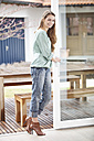 Germany, Bavaria, Young woman  smiling, portrait - MAEF004570