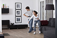 Germany, Bavaria, Young couple playing with game console - MAEF004621
