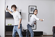 Germany, Bavaria, Young couple playing with game console - MAEF004622