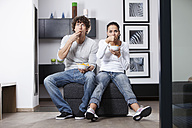 Germany, Bavaria, Young couple watching TV - MAEF004625