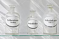 Germany, Bavaria, Munich, Old pharmacy flask in window display - LFF000465