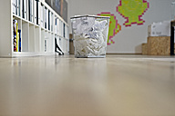 Germany, Cologne, Basket with waste paper in apartment - RHYF000014