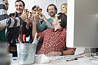 Germany, Cologne, Men and women toasting with champagne in office - RHYF000071