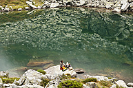 Austria, Styria, Man and woman having rest at Lake Obersee - HHF004083