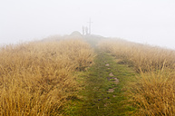 Austria, Styria, Man and woman walking on way  to summit at Reiteralm - HHF004087