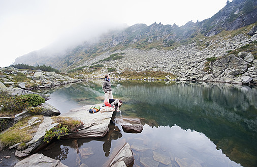 Austria, Styria, Man and woman having rest at Lake Obersee - HHF004093