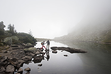 Austria, Styria, Man and woman walking near Lake Spiegelsee - HHF004094