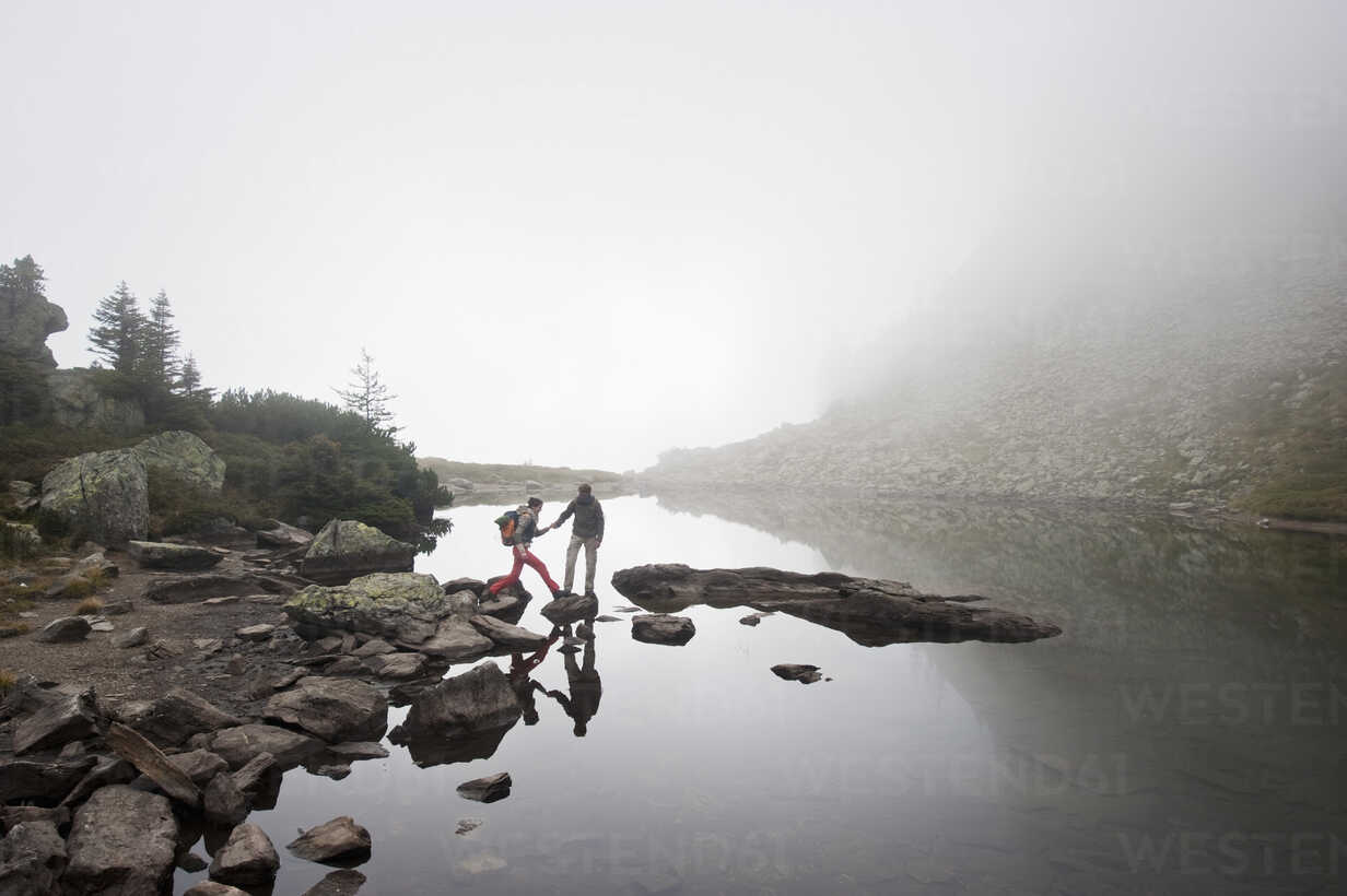 Austria, Styria, Man and woman walking near Lake Spiegelsee - HHF004094 - Hans Huber/Westend61