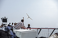Netherlands, Bird flying over ferry - DW000167