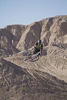 USA, California, Mountain biker jumping in air - FFF001283