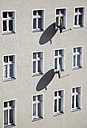 Germany, Berlin, House front with satellite dishes - JMF000121