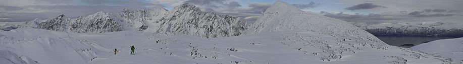 Norway, Lyngen, Skiers walking on snow - FFF001301