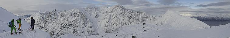 Norway, Lyngen, Skiers standing on polar peak - FFF001300