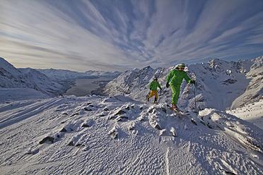 Norway, Skiers walking donwhill - FFF001295