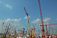 Germany, Bavaria, Munich, Cranes at trade fair - AX000037