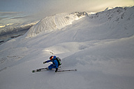 Norway, Mature man skiing on step mountain - FFF001308
