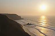 Portugal, Algarve, Sagres, View of beach at sunset - MIRF000424