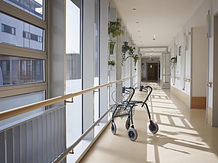 Germany, Cologne, Walking frame in corridor of nursing home - WESTF018700