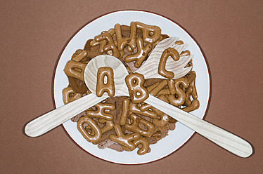 Character salad with salad servers on brown background - MUF001208